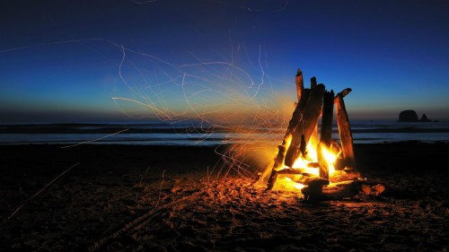 Bonfire in the sand on the beach