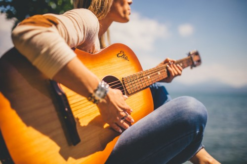 Girl playing guitar. Musical Instrument