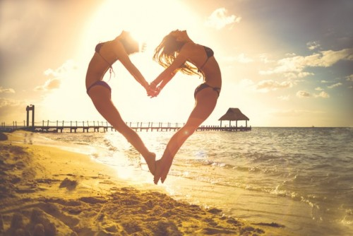 Joyful  jumping  life  love. Beach  heart,  Holiday, Sand  Sea,  Sun  vacation  women.