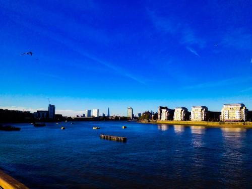 The image clicked from cutty sark and show views of canary Wharf and other places
