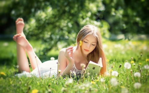 Girl Reading A Book In Garden