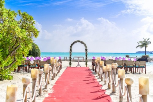 Beach Wedding Event Under White Clouds & Sky during daytime