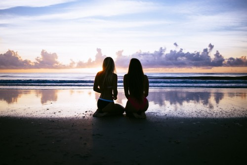 GIrls Watching The Sunset On Wet Sand