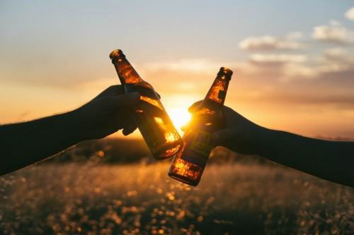Cheers with Beer During Sunset