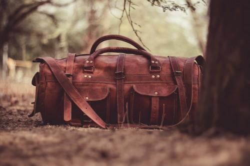 Brown Handbag Near Tree