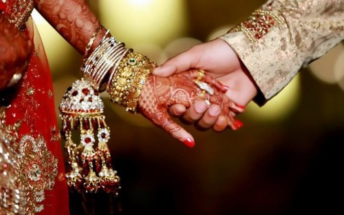 Indian couple holding hand