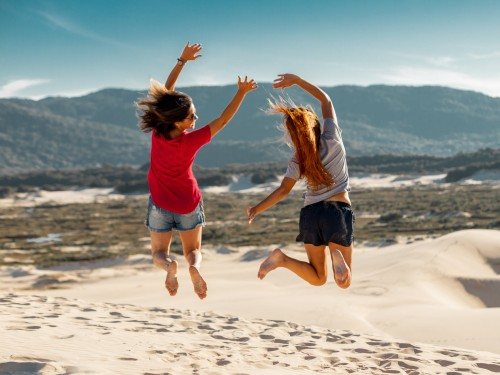 Jump shot photography of two women