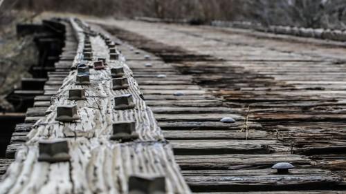 Iron bolts fastening wooden bridge