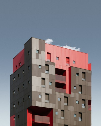 Cubic red and brown coloured building