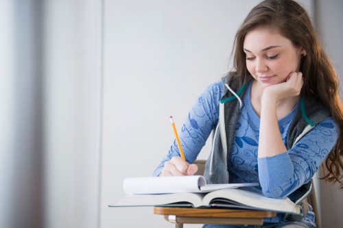 Beautiful Girl busy in Study