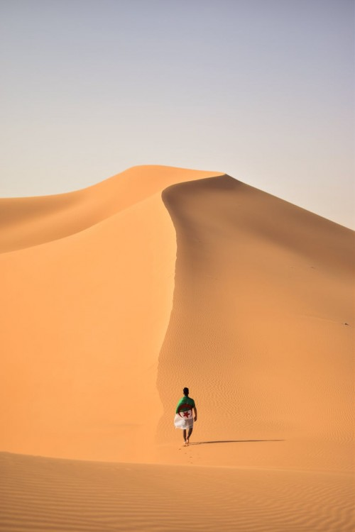 Man-walking-on-desert