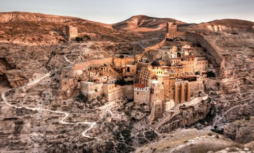 "The sun rises over Mar Saba monastery, which seems to spill from the earth in Israel's Judaean Desert. ""Considered to be one of the oldest inhabited monasteries in the world,"" Your Shot photographer Maria Yudin explains—and it is, at well over a thousand years old—""[it] still maintains many of its ancient traditions. One in particular is the restriction on women entering the main compound."" Women can look over the complex from a separate tower constructed expressly for their use."