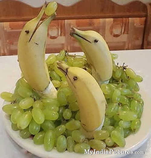 Dolphin made by bananas and grapes