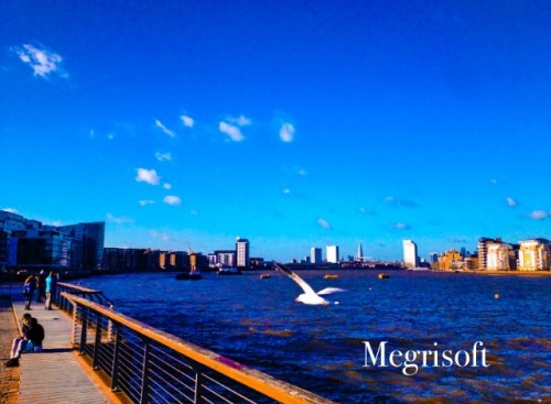 This pic gives London view from east covering blue water of Thames, tall building, canary wharf birds and sunshine. The Image was taken on Ist Jan 2015 While I was enjoying first day of new year at Curry Sark